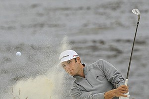 Dustin Johnson hits out of a bunker on the eighth hole during the second round of the U.S. Open golf tournament Friday, June 18, 2010, at the Pebble Beach Golf Links in Pebble Beach, Calif.