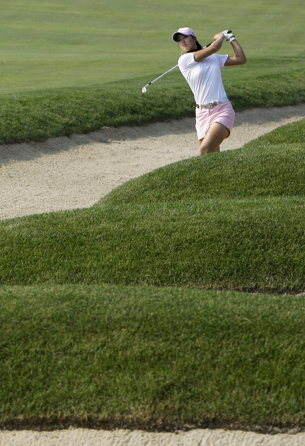 Michelle Wie hits out of a bunker on the 15th hole during the first round of the U.S. Women's Open golf tournament at Oakmont Country Club in Oakmont, Pa., Thursday, July 8, 2010.