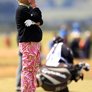 John Daly of the U.S. reacts after playing a shot onto the sixth green during the second round of the British Open Golf Championship on the Old Course at St. Andrews, Scotland, Friday, July 16, 2010.