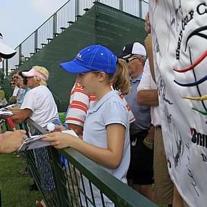 Rory McIlroy, from Northern Ireland, signs autographs during the practice round of the Bridgestone Invitational at Firestone Country Club, Wednesday, Aug. 4, 2010, in Akron, Ohio.