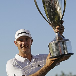Dustin Johnson holds the J.K. Wadley trophy after winning the BMW Championship golf tournament in Lemont, Ill., Sunday, Sept. 12, 2010. Johnson finished 9-under par.