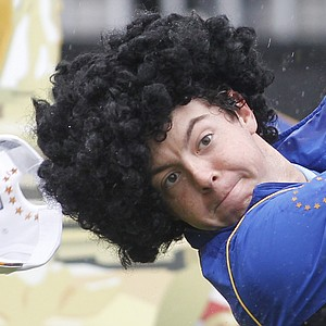 Europe's Rory McIlroy wearing a curly wig hits a tee shot during a practice round at the 2010 Ryder Cup golf tournament at the Celtic Manor golf course in Newport, Wales, Wednesday, Sept. 29, 2010.