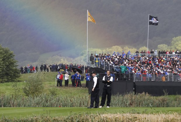 A rainbow is seen as Europe's Rory McIlroy, left, and assistant captain Sergio Garcia look on at the 14th hole on the third day of the 2010 Ryder Cup golf tournament at the Celtic Manor Resort in Newport, Wales, Sunday, Oct. 3, 2010.