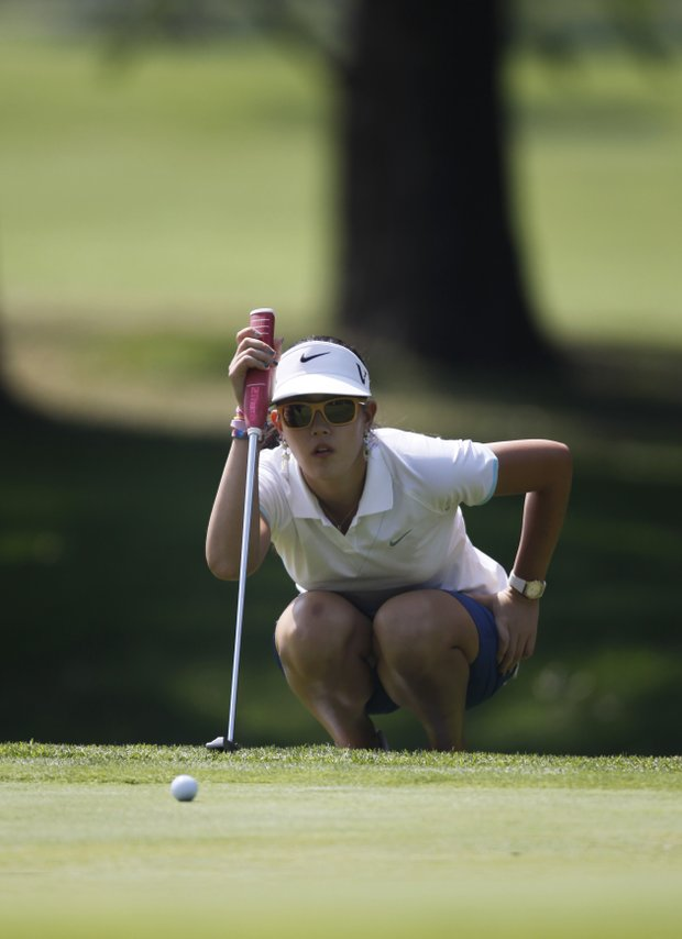 US' Michelle Wie lines up a putt on the 2th hole during the first round of the Lorena Ochoa Invitational LPGA golf tournament in Guadalajara, Mexico, Thursday, Nov. 11, 2010.