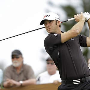 Dustin Johnson follows his drive from the third tee during the second round of the Hyundai Tournament of Champions golf tournament in Kapalua, Hawaii Friday, Jan. 7, 2011.