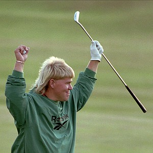 John Daly raises his arms in triumph after winning the British Open in a four-hole playoff with Constantino Rocca at St. Andrews, Old Course, Sunday, July 23 1995.