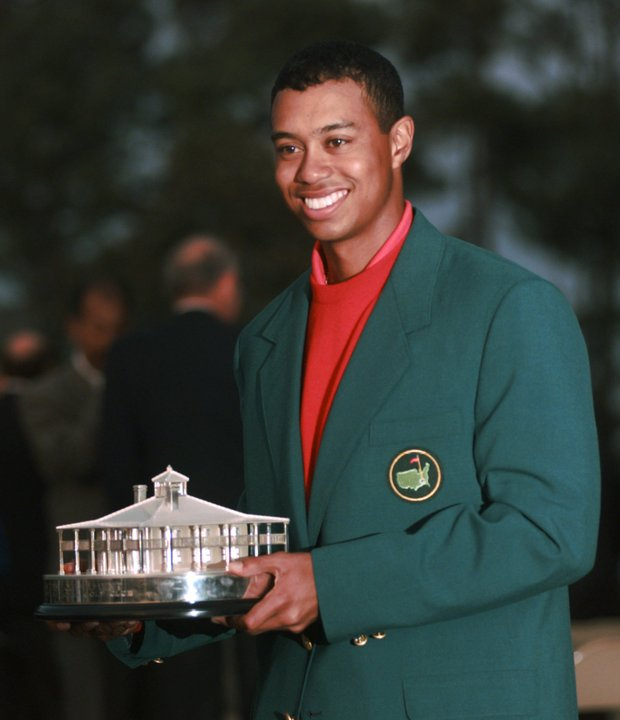 Masters champion Tiger Woods holds a replica of the Masters Trophy after winning the tournament at the Augusta National Golf Club in Augusta, Ga., Sunday, April 13, 1997.