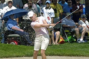 Morgan Pressel hits out of a bunker on the 18th hole during the LPGA Championship tournament at locust Hill Country Club in Pittsford, N.Y., June 24, 2010.