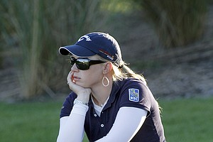 Morgan Presel sits on her bag at the 17th green during the LPGA Tour Championship in Orlando, Fla. Dec. 4, 2010.