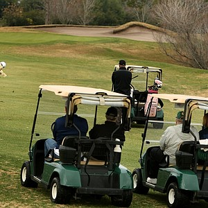 A few carts trail Brittany Lincicome during her opening round of the Hooters Tour Winter Series event at Deer Island.