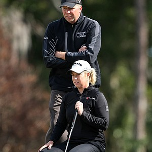 Brittany Lincicome and friend Nick Frontero line up a putt in a Hooters Tour Winter Series event at Deer Island.