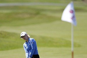 Morgan Pressel plays a chip shot on the 18th hole during the Women's British Open at Royal Birkale Golf Club in Southport, England, July 31, 2010.