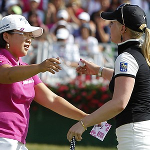 Jiyai Shin of South Korea celebrates with Morgan Pressel, right, after winning the Evian Masters women's touranment in Evian, France, July 25, 2010.