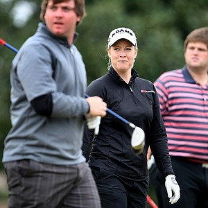 LPGA player Brittany Lincicome, center, walks off a tee box with playing partners Zack Sucher, left, and Jay Whitby. The trio were playing in a Hooters Tour Winter Series event at Deer Island.