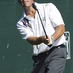 Stuart Appleby, of Australia, chips to the 18th green during the first round of the Sony Open golf tournament on Friday, Jan. 14, 201, in Honolulu.