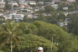 Jonathan Byrd reacts to his putt on the 16th green during the first round of the Sony Open in Honolulu.