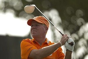John Daly follows his drive off the 12th tee during the first round of the Sony Open, Friday, Jan. 14, 2011, in Honolulu.