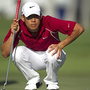 Anthony Kim lines up his putt on the 13th green during the first round of the Sony Open golf tournament, Friday, Jan. 14, 2011, in Honolulu.