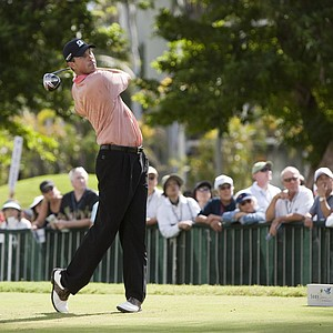 Matt Kuchar tees off on the first hole during the first round of the Sony Open golf tournament on Friday, Jan. 14, 201, in Honolulu.