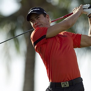 Camilo Villegas, of Colombia, follows his drive off the 14th tee during the first round of the Sony Open, Friday, Jan. 14, 2011, in Honolulu.