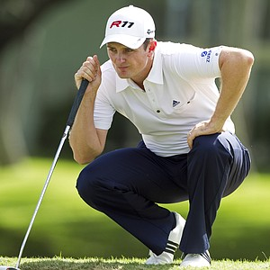 Justin Rose lines up his putt on the first green during the second round of the Sony Open golf tournament, Saturday, Jan. 15, 2011, in Honolulu.