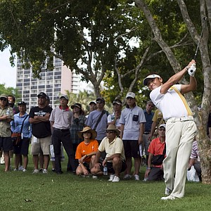 Shigeki Maruyama hits his shot out of the rough on the sixth hole during the second round of the Sony Open golf tournament, Saturday, Jan. 15, 2011, in Honolulu.