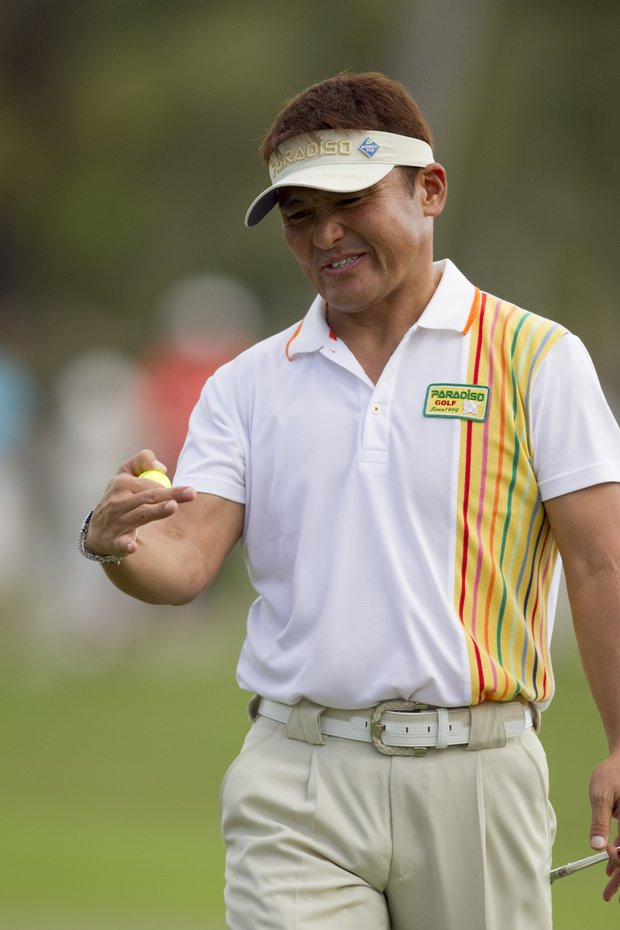 Shigeki Maruyama reacts to a putt on the first hole during the second round of the Sony Open golf tournament, Saturday, Jan. 15, 2011, in Honolulu.