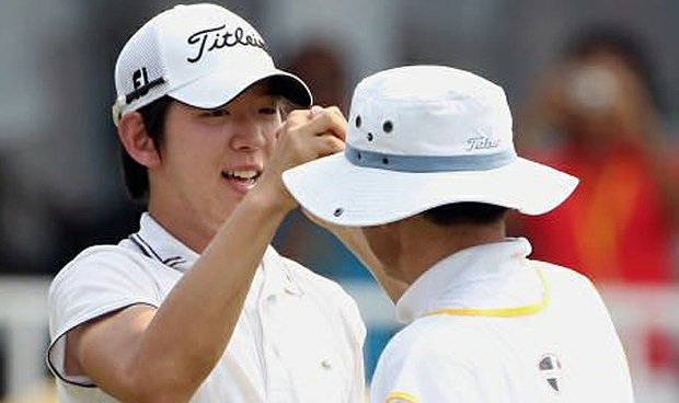 Seung-yul Noh with his father, caddie and friend.