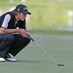 Adam Scott lines up his putt on the 16th hole during the first round of the Deutsche Bank Championship at the Tournament Players Club of Boston in Norton, Mass., Friday, Sept. 3, 2004.