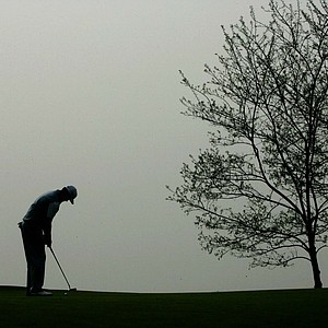 Australia's Adam Scott is silhoetted as he putts the ball during his second round in the Johnnie Walker Classic golf tournamen at Pine Valley Golf resort in Beijing, Saturday, April 23, 2005. Scott finished his second round at 15 under par, after he set a new course record after firing a 9-under-par 63 Friday for a three stroke lead after the delayed first round.