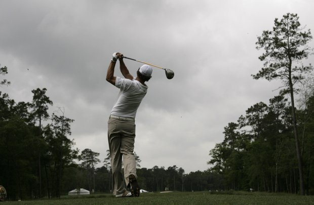 Defending champion Adam Scott, of Australia, hits his tee shot on the second hole during the first round of the Houston Open golf tournament Thursday, April 3, 2008 in Humble, Texas. Scott shot a course record 9-under-par 63 and is the early clubhouse leader.