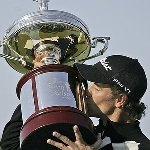 Adam Scott of Australia kisses the Byron Nelson Championship golf trophy after winning the tournament in Irving, Texas, Sunday, April 27, 2008. Scott made a 9-foot birdie putt on No. 18 to force a playoff, then made a 48-footer playing it again on the third playoff hole to beat Ryan Moore.