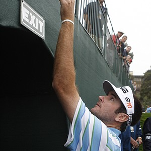 Bubba Watson hands a ball to a spectator after his practice round for the US Open at Torrey Pines Golf Course Tuesday, June 10, 2008 in San Diego.