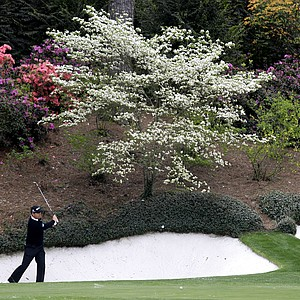 Padraig Harrington of Ireland chips onto the 12th green during his practice round for the Masters golf tournament at the Augusta National Golf Club in Augusta, Ga., Tuesday, April 7, 2009.