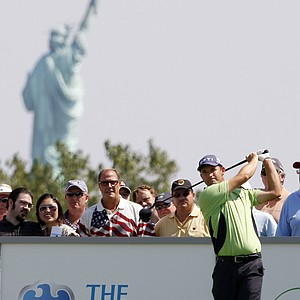 Padraig Harrington, of Ireland, tees off on the third hole during the final round of The Barclays golf tournament at Liberty National Golf Club Sunday, Aug. 30, 2009, in Jersey City, N.J.