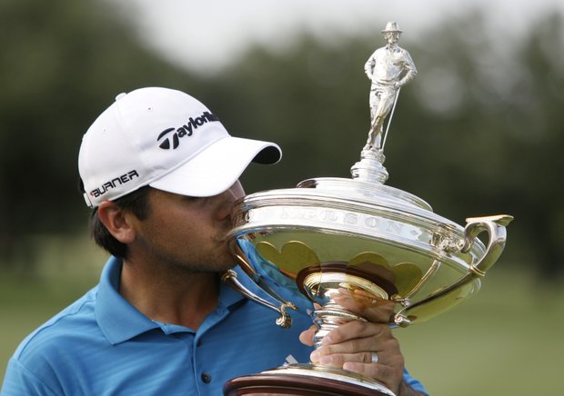 Jason Day kisses the trophy following his victory in the Byron Nelson Championship golf tournament Sunday, May 23, 2010, in Irving, Texas.