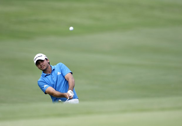 Jason Day, of Australia, chips onto the 16th green during the final round of the Byron Nelson Championship golf tournament Sunday, May 23, 2010, in Irving, Texas. Day won the tournament at 10 under par.