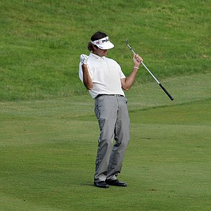 Bubba Watson celebrates after hitting his approach shot on the first playoff hole to two inches during the final round of the Travelers Championship golf tournament in Cromwell, Conn., on Sunday, June 27, 2010. Watson won the tournament on the second playoff hole.