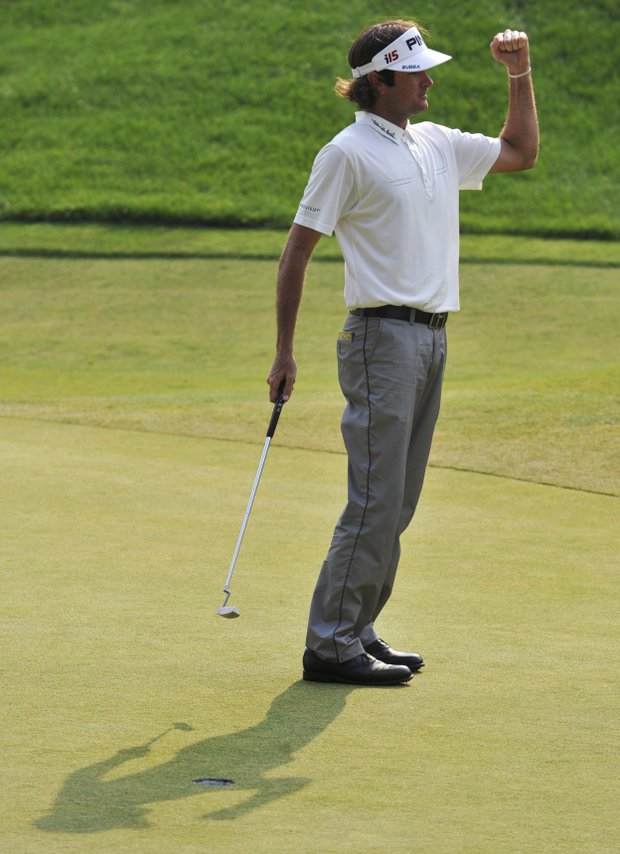 Bubba Watson pumps his fist after a birdie on 18th hole that forced a three-way playoff with Corey Pavin, and Scott Verplank at the final round of the Travelers Championship golf tournament on Sunday, June 27, 2010, in Cromwell, Conn.