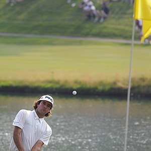 Bubba Watson chips onto the 17th green during the final round of the Travelers Championship golf tournament in Cromwell, Conn., on Sunday, June 27, 2010. Watson won for the first time on the PGA Tour, coming from six shots down to win the Travelers Championship in a three-way playoff.
