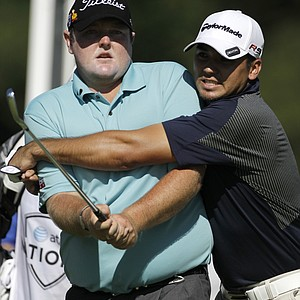 Jarrod Lyle left, and Jason Day, both of Australia, joke around before teeing off on the seventh hole during the second round of the AT&T National golf tournament at the Aronimink Golf Club, Friday, July 2, 2010, in Newtown Square, Pa.