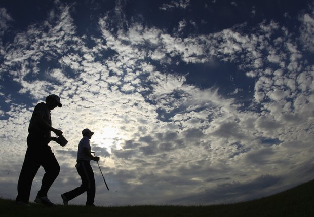 This image made with a fisheye lens shows Tim Petrovic, left, and Jason Day of Australia walking down the 17th fairway during the second round of the PGA Championship golf tournament Saturday, Aug. 14, 2010, at Whistling Straits in Haven, Wis.