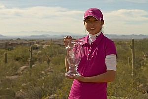 Paige Lee holds her trophy for winning the Golfweek West Coast Junior Invitational at the Troon North Monument Course in Scottsdale, Ariz.