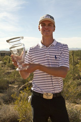Michael Moorhead holds his trophy after winning the Golfweek West Coast Junior Invitational at the Troon North Monument Course in Scottsdale, Ariz.