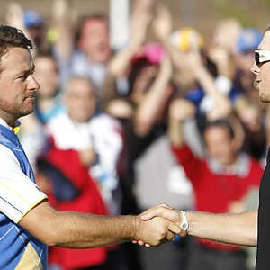 Hunter Mahan, right, of the U.S. congratulates Europe's Graeme McDowell after Europe won the 2010 Ryder Cup at the Celtic Manor Resort in Newport, Wales, Oct. 4, 2010.
