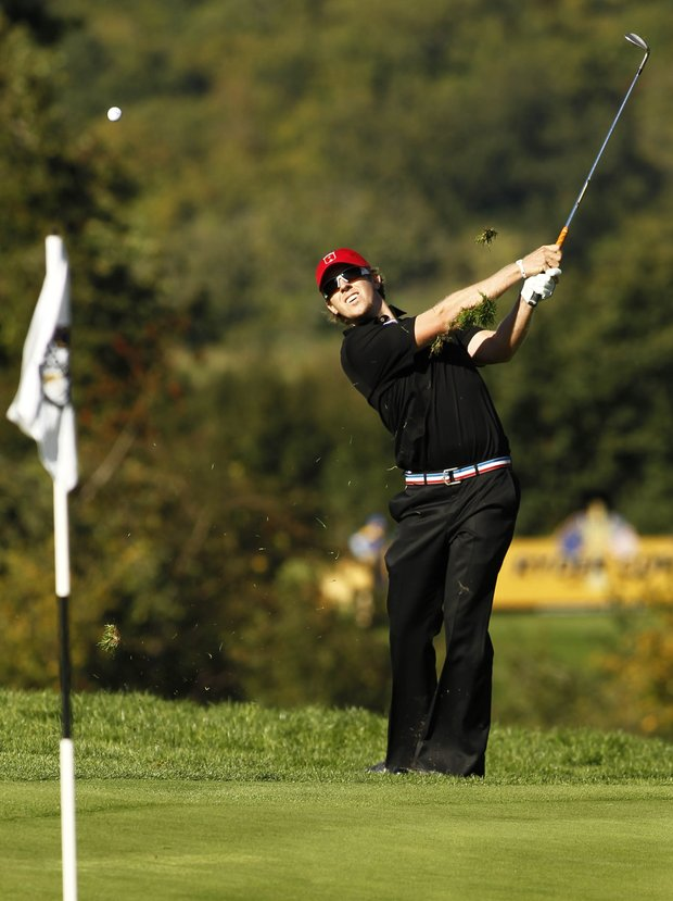 Hunter Mahan plays a shot on the 15th hole during the final of day of the 2010 Ryder Cup at Celtic Manor Resort in Newport, Wales, Oct. 4, 2010.