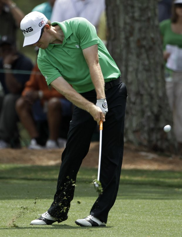 Hunter Mahan hits off the first fairway during the third round of the Masters in Augusta, Ga., April 10, 2010.