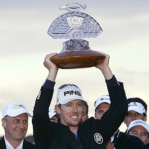 Hunter Mahan holds the winner's trophy at the Phoenix Open after the final round in Scottsdale, Ariz., Feb. 28, 2010. Mahan finished the tournament 16-under-par, one stroke ahead of Rickie Fowler.