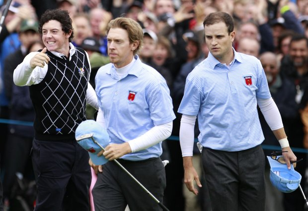 Roy McIlroy, left, of Europe reacts as Hunter Mahan, center, and Zach Johnson look on during the thrid day of the 2010 Ryder Cup at the Celtic Manor Resort in Newport, Wales, Oct. 3, 2010.