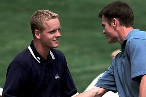 Luke Donald, left, of England, is congratulated by Andy Miller of Napa, Calif., after Donald eliminated Miller, 5 and 3, in match play during the second round of the U.S. Amateur Championship at Baltusrol Golf Club in Springfield, N.J., Thursday, Aug. 24, 2000.